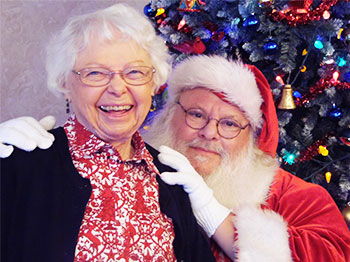 Residents at The Arboretum Senior Living Community pose for pictures with santa.