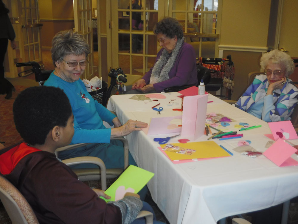 Residents at Immanuel Village create Valentine's Day cards with students from Masters Elementary