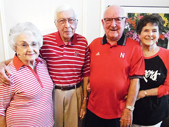 Residents at The Arboretum, an Immanuel community, wear Husker gear at their annual Big Red Breakfast event.