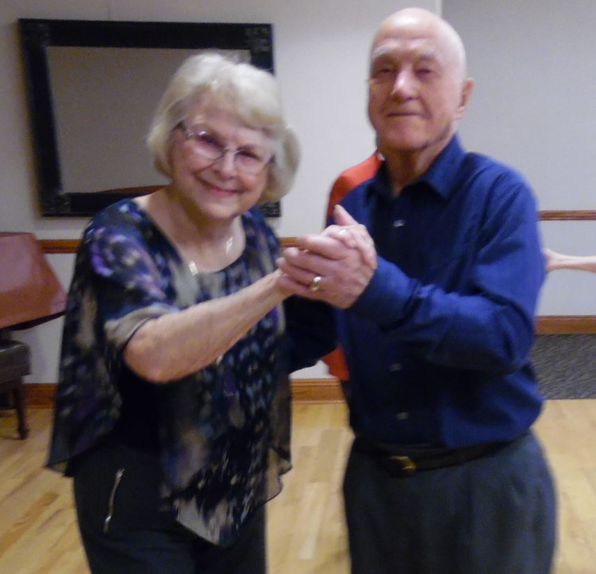 Residents from The Landing retirement community dance the night away at the community's Valentine's Day Dance