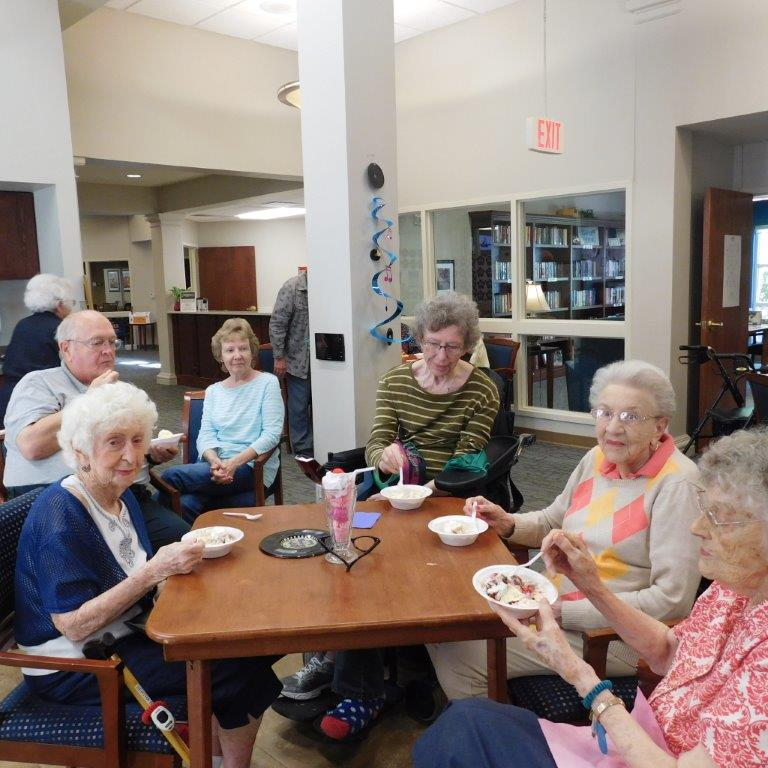 Residents eat their gutter banana split at Clark Jeary senior living community.