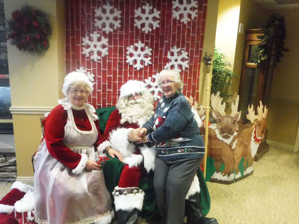 Residents from Immanuel Village, an Immanuel senior living community, pose for a photo with Santa when celebrating Christmas